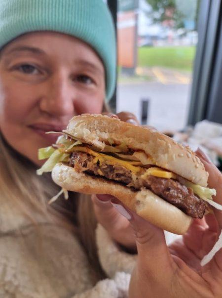 woman holding new McDonald's vegan burger