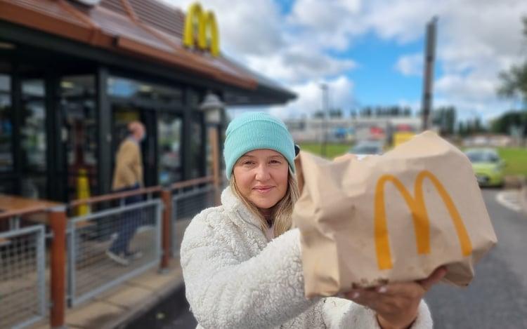 woman holding McDonald's bag