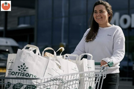 Morrisons shopper with branded bags