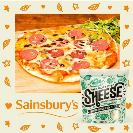packet of  Sheese  and  a pizza  with it grated  on