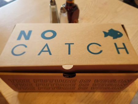 a closed box of food at No Catch restaurant